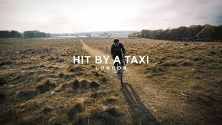hit by a taxi...