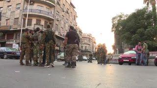 أخبار عربية - داعش يتبنى الهجمات الانتحارية على مقر قيادة شرطة دمشق