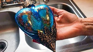 Woman Buys $2 Blue Heart At Thrift Store. 2-Years Later, She Spots Something Hidden Inside.