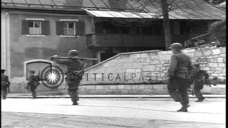 Soldiers of 101st Airborne Division 506th PIR 3rd BN walk on streets in Germany d...HD Stock Footage