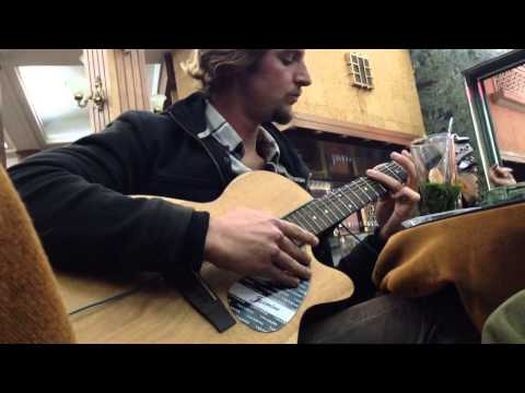 American With Guitar In Tangier Cafe