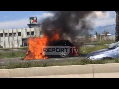 Report TV - Aksident i frikshëm në Tiranë-Durrës, njëra nga makinat në flakë, tjetra përmbyset