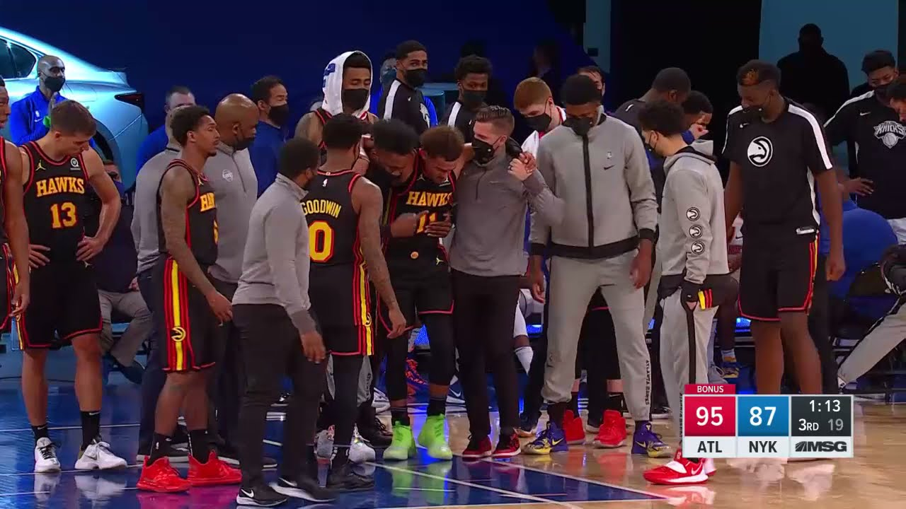 Trae Young helped off court after rolling left ankle