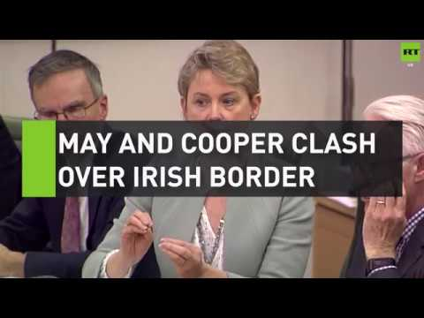 May and Cooper clash over Irish border at committee