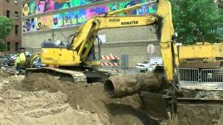 Komatsu PC308USLC excavator removing a sewer pipe