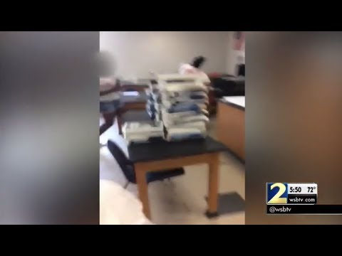 Video shows teacher and paraprofessional fighting in front of middle schoolers