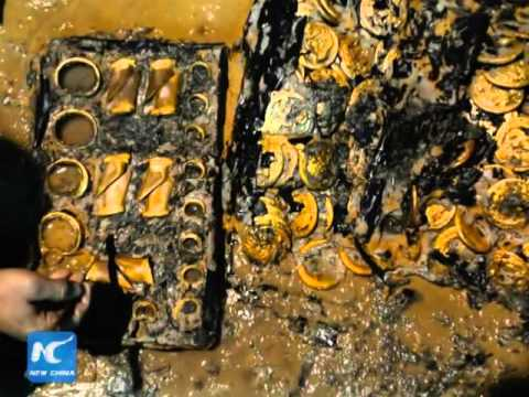 Massive gold coins, hooves found in 2,000-year-old Chinese tomb