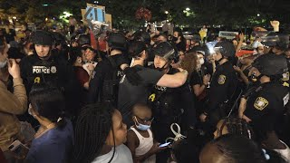 Police kneel, hug and pray with protesters in Lexington on Monday night
