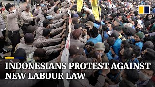 Indonesian Police Fire Tear Gas As Thousands Of People Protest Against New Labour Law