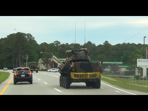 Marines Cruising In A LAV On The Highway In Havelock, NC