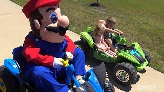 Super Mario Steals Kids Power Wheels Ride on Car! Funny Mario Kart Race IRL