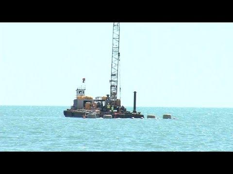 Coast Guard recovering sunken barge off Naples coast