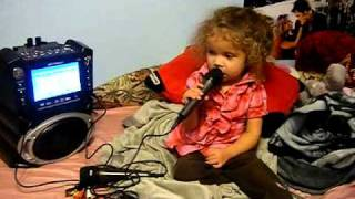 "Sophia Singing ""Untouchable"" on the karaoke machine"