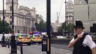 Pedestrians hurt as car hits barrier at UK parliament, man arrested