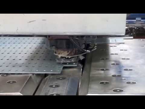 Trumpf 200 CNC punch press punching brackets down the chute