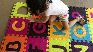 Sisters putting together a GIANT ABC carpet!!