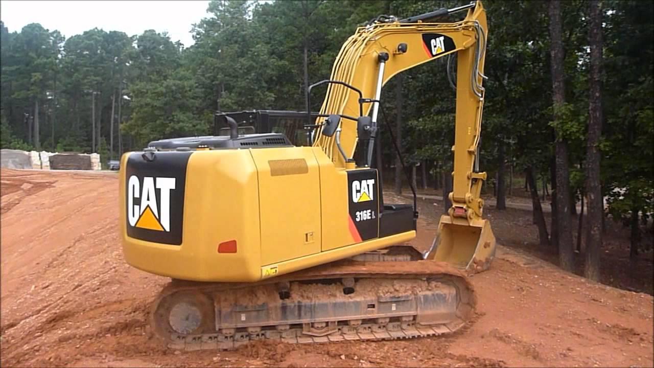 Repeat Cat 316E Excavator Performing Hillside Climb and