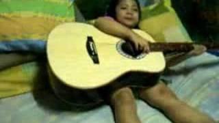 sylvia playing guitar