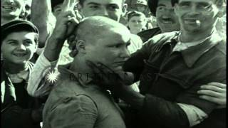 A woman collaborator with shaved head marched  after the Liberation of Paris duri...HD Stock Footage