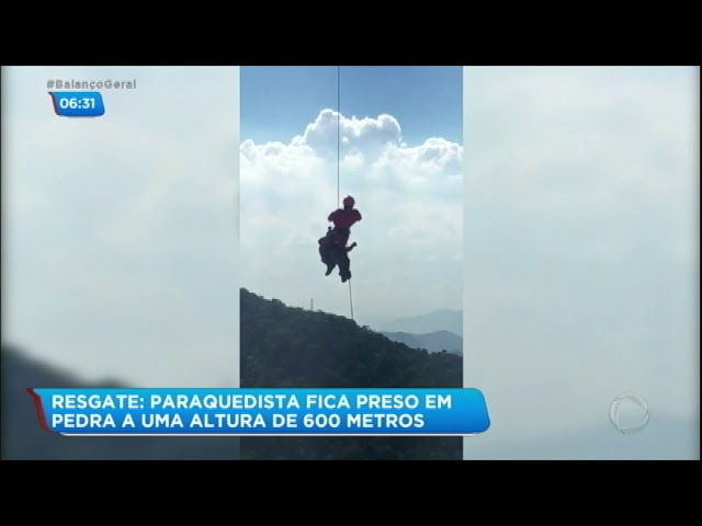 Paraquedista fica preso em pedra a 600 metros de altura