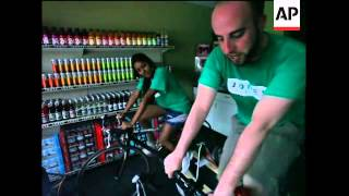 Employees ride bicycles to power a firm for a day