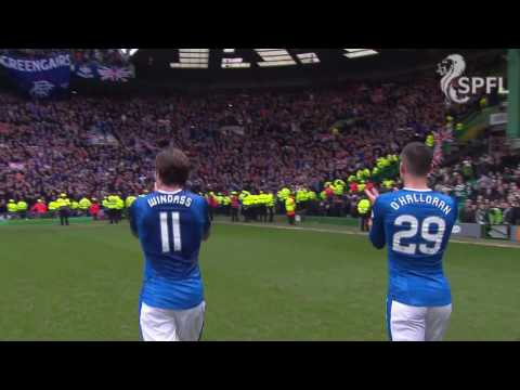 Rangers players celebrate after draw with Celtic