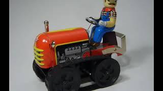 Серж - А я работаю на тракторе