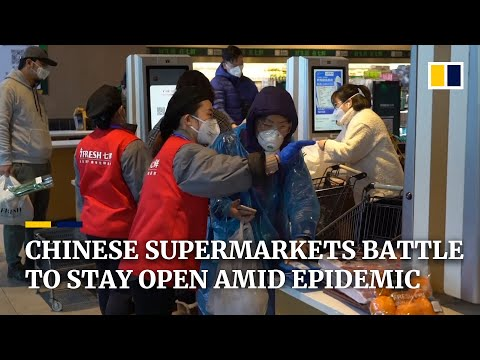 Chinese supermarkets battle to stay open during the coronavirus epidemic