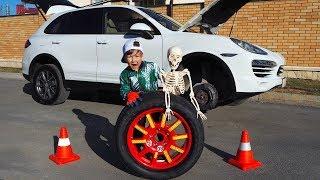 Senya fixing a missing wheel of a Porsche