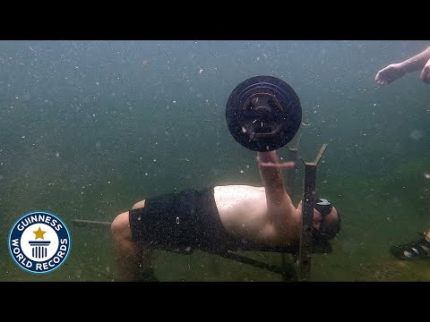 Man breaks Guinness World Record for most consecutive bench presses underwater - Video