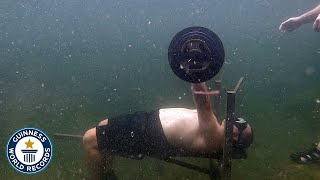 Most bench presses underwater - Guinness World Records