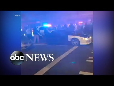 Police SUV seen plowing through crowd …