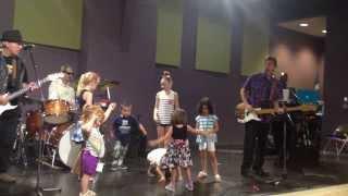 the mo dels band at morgans wonderland amusement park performing the song you never can tell