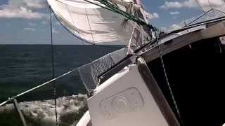 """Sailing in gusty conditions on the Potomac River, Chesapeake Bay, on Pearson 28 """"Thoe""""."""