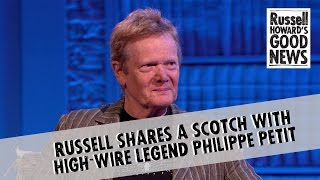 Russell shares a scotch with high-wire legend Philippe Petit
