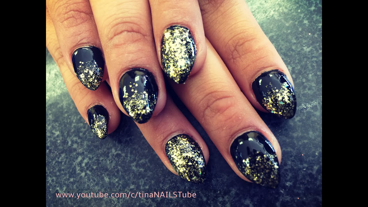 Gold and black stiletto nails forecasting to wear in winter in 2019