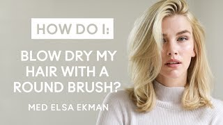 How do I blow dry my hair with a round brush?