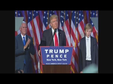 Barron Trump struggles to stay awake during Dad's victory speech