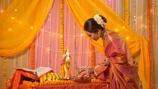 Indian woman wearing beautiful saree lighting diya for 'aarti ki thali' - Krishan Janmashtami