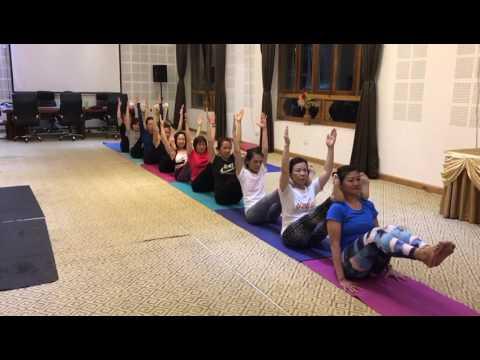 Group Yoga Class at Bhutan - Navasana (Boat Pose)