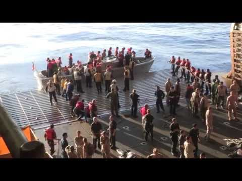 U.S. Navy Rescue 282 Migrants from Overcrowded Sinking Vessel in Mediterranean Sea