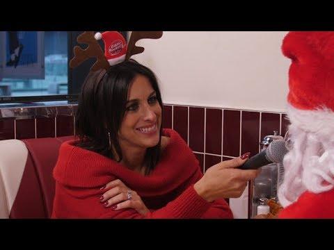 Lucy Kennedy interviews Santa in Eddie Rocket's 1