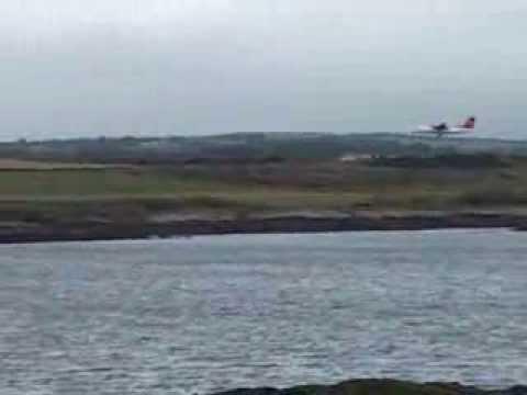 Plane landing at Ronaldsway Airport Isle of Man IOM Manx