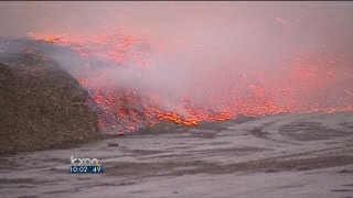 High winds fuel mulch fire