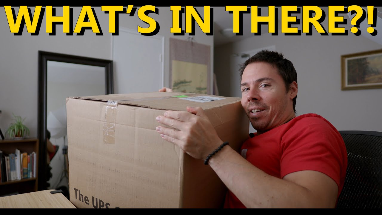Unboxing A Mystery Package: Cameras AND Lenses?!