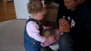 **cutest Kid Changing A Baby Doll**