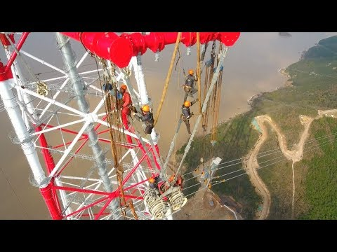 Technicians Complete Treacherous Power Grid Connection Work in East China
