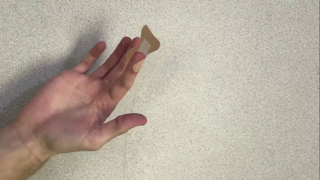 how to put on a fingertip bandage - YouTube