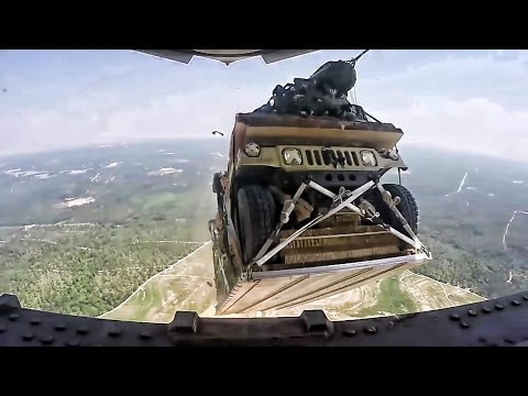 Humvees Parachute From Plane