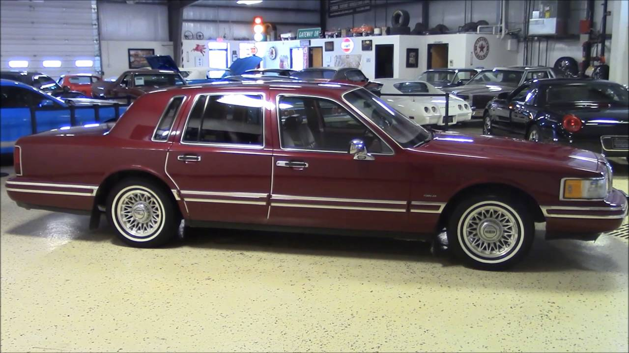 magazine features town red lowrider lincoln wine car side